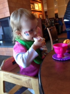 Grace eating at Tea party