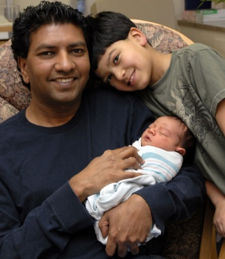 1_Shutterstock_E-Indian-Father-and-Son-with-new-baby