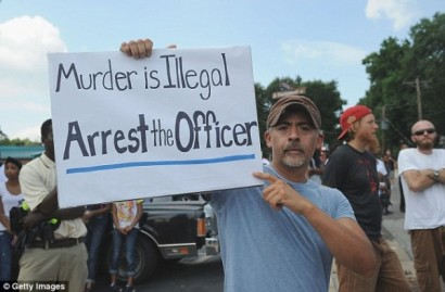 ferguson.police.protests.michael.brown_.anonymous02_occupycorporatism-600x394