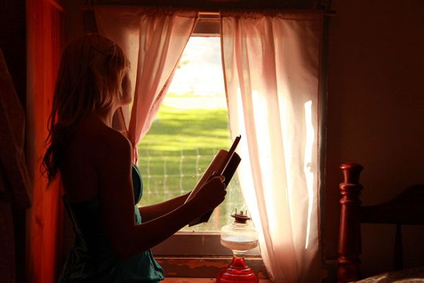 670px-Girl-Holding-Book-Looking-Out-Window-free-creative-commons-3