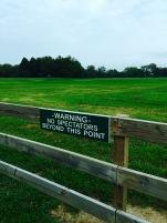 buder park black sign on fence