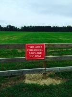 buder park red sign on fence