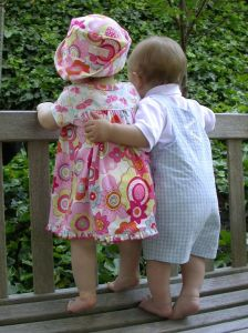 children toddlers hugging from behind